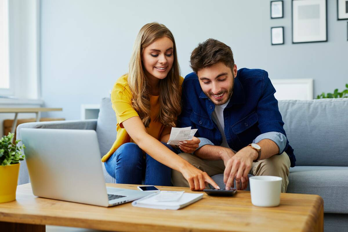 happy couple calculating unsecured loan repayments