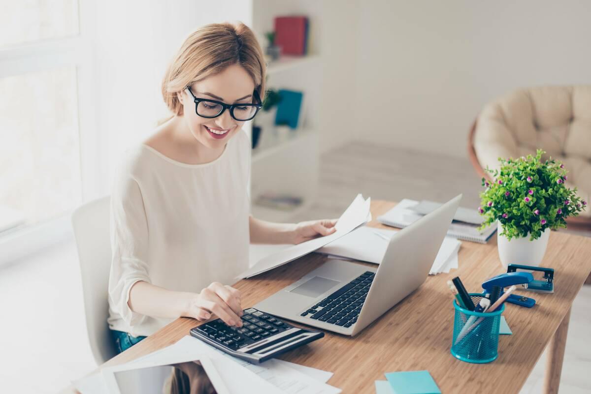 smiling woman calculating loan repayments