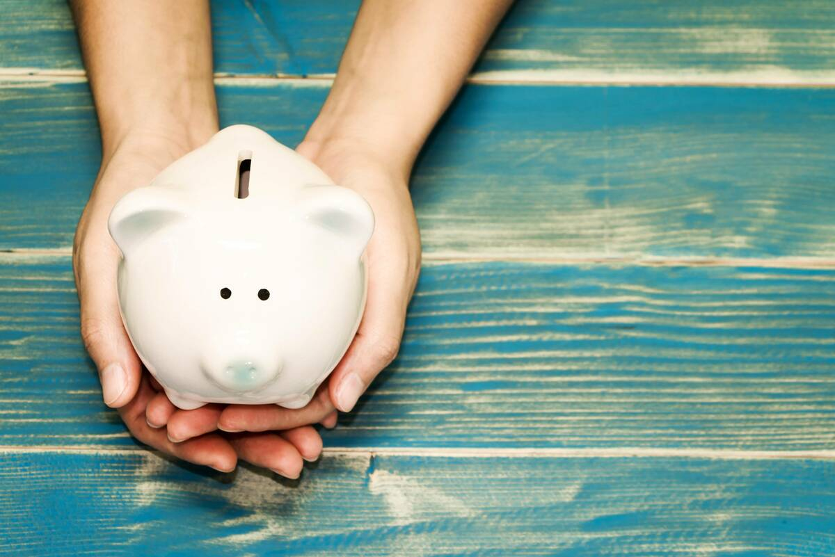 hands holding savings in piggy bank