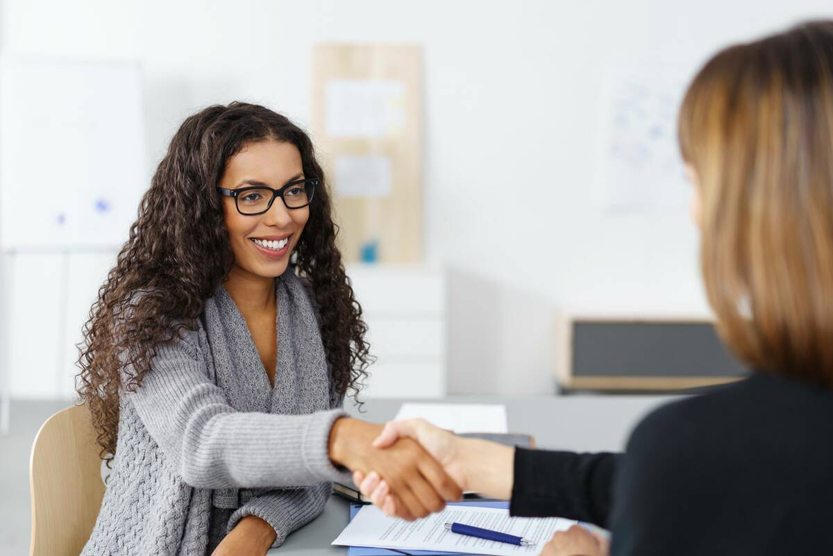 loan applicant shaking hands with lender