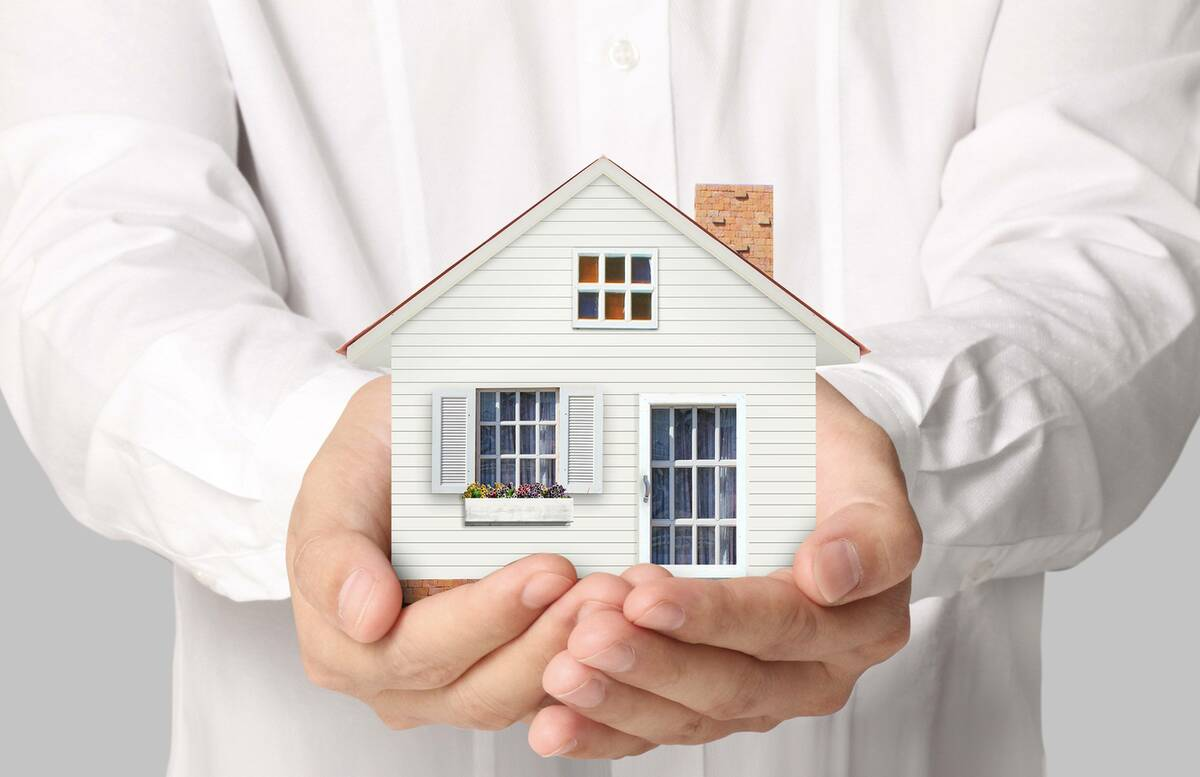man holding house secured against loan