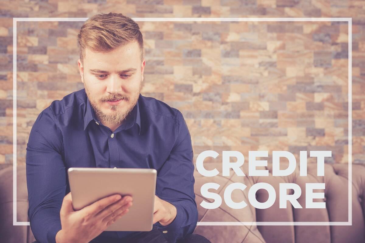 gentleman looking up his credit score